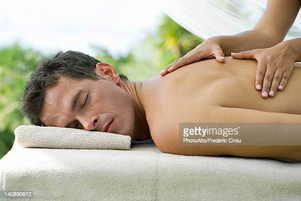 man getting massage - sensual massage stock photos and pictures