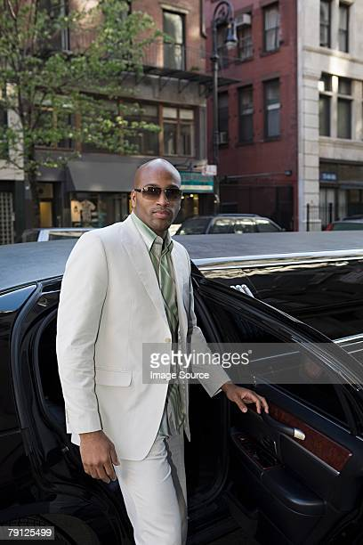 man getting out of limousine - best sunglasses for bald men stock pictures, royalty-free photos & images