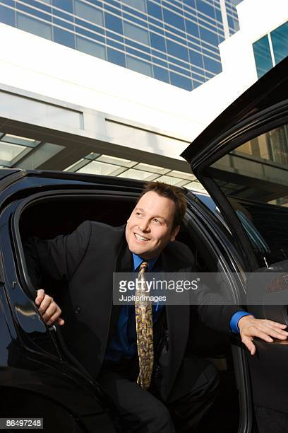 Man getting out of limousine
