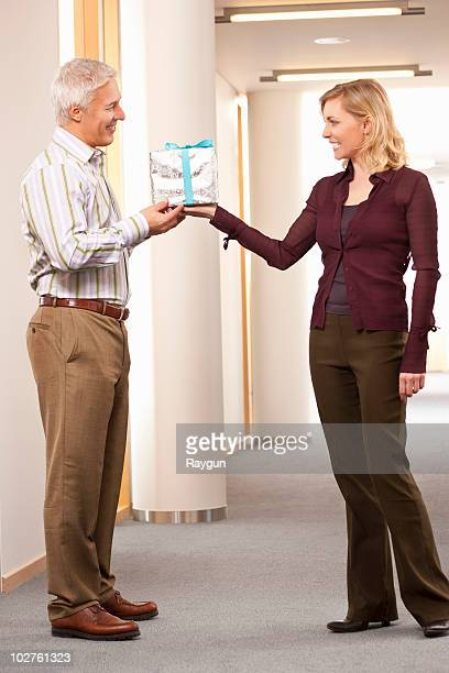 Man getting present from employee