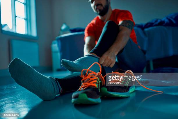 man getting ready for a workout - sock stock pictures, royalty-free photos & images