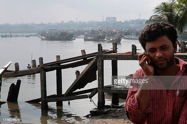 A man gives a phone call at the Cox's Bazar fishing port