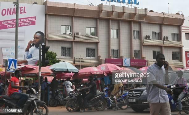 Man gives a phone call at the mobile phone market in Ouagadougou Burkina Faso on September 23, 2019.