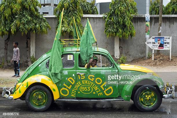A man gives a thumbs up from a Volkswagen Beetle with the slogans 'Old is Gold' and another loosely translated meaning 'take care of it and it will...