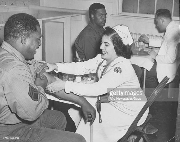 A man gives blood at the red cross on the army base at Aberdeen Proving Ground during World War 2 Baltimore Maryland 1943