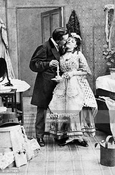 A man gives his girlfriend a good night kiss