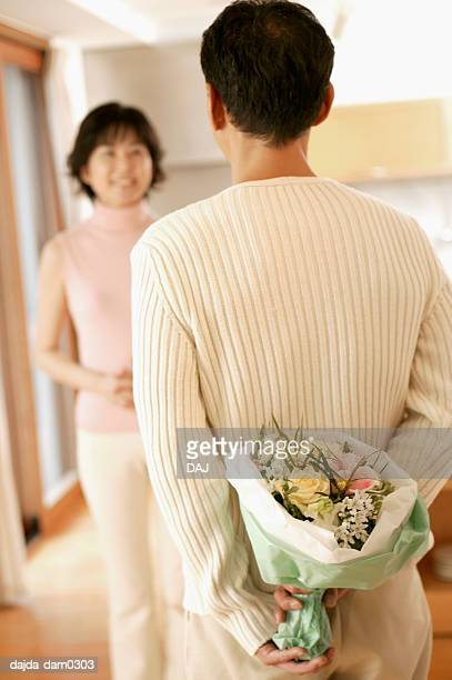 Man giving a  bouquet