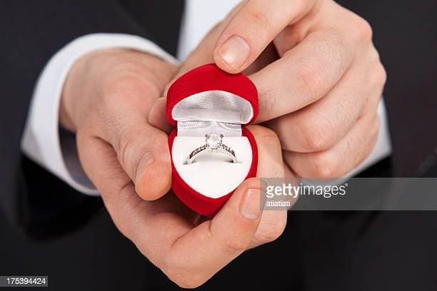 man giving a diamond ring
