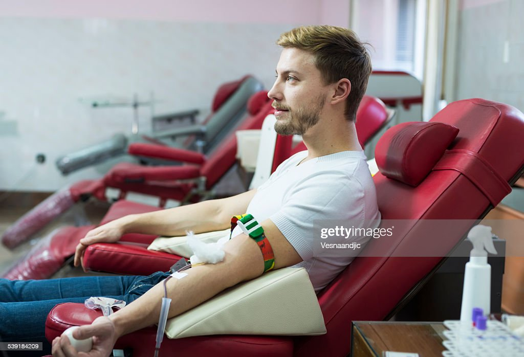 Man giving blood donation : Stock Photo
