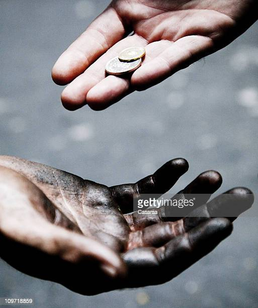 Man Giving Change to Other Male