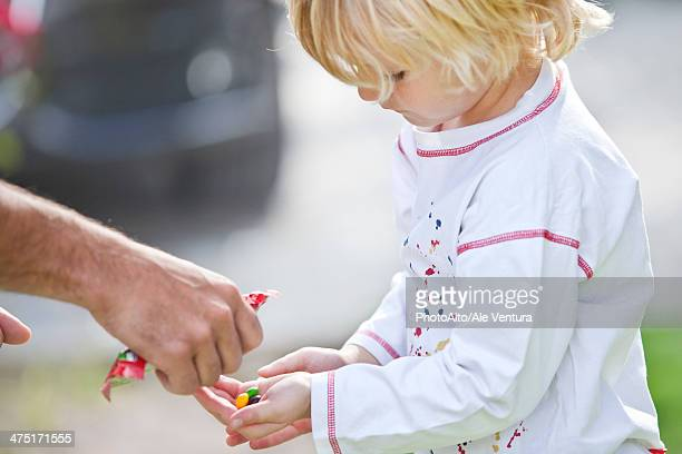 Man giving child candies