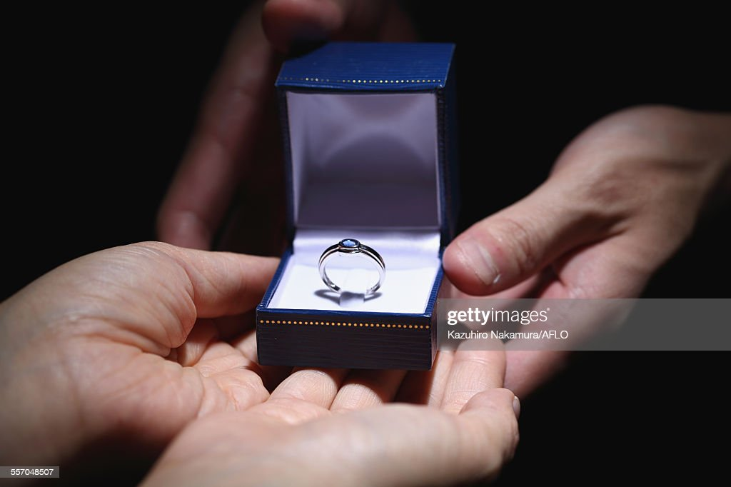 Man giving engagement ring : Stock Photo