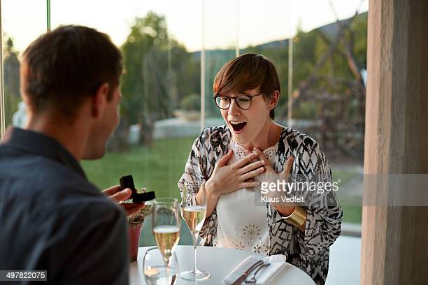 Man giving engagement ring to girlfriend