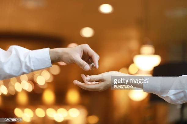 Man giving engagement ring to woman