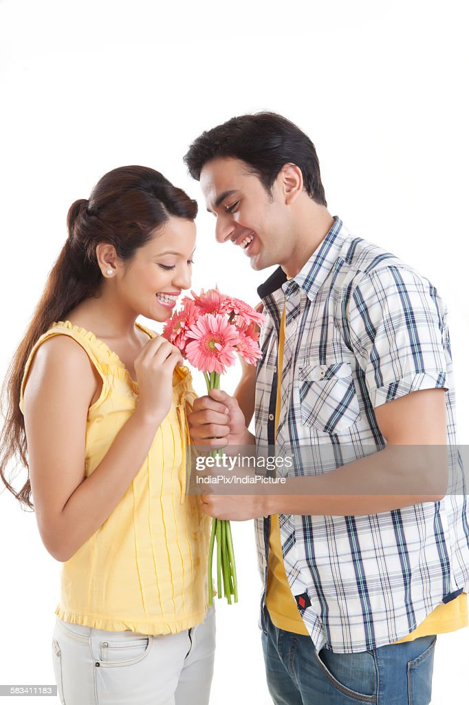 Man giving flowers to woman : Stock Photo