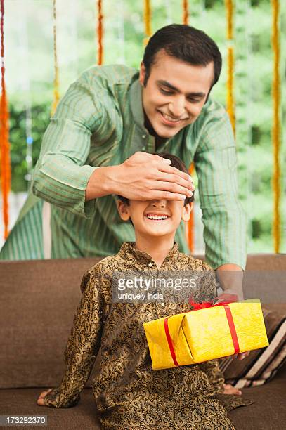 Man giving gift to his son on Diwali