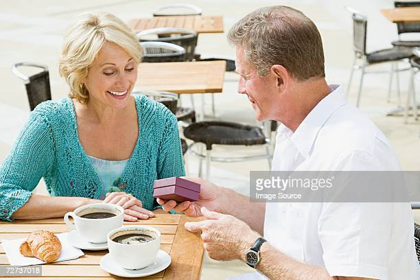 Man giving gift to wife