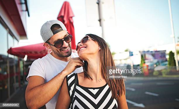 Man giving his wife a necklace as gift