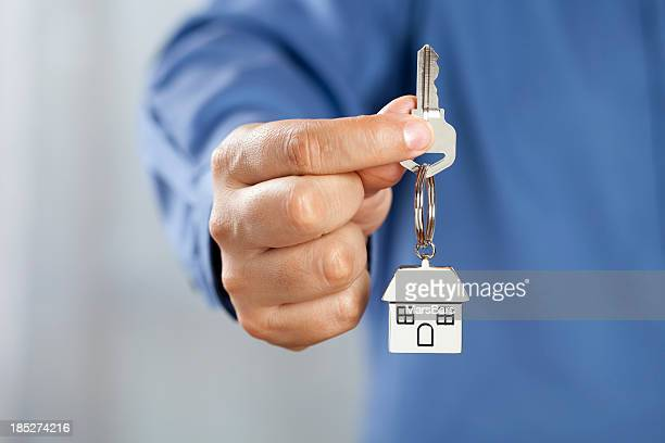 Man giving house keys