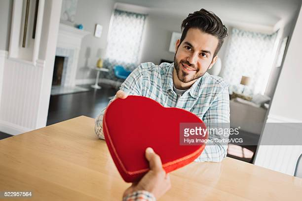 Man giving man gift box