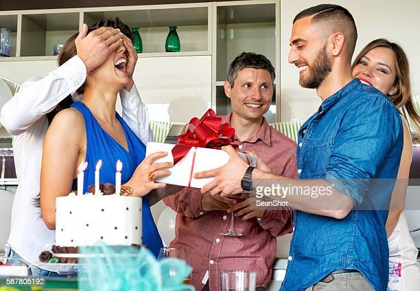 Man Giving present during a Birthday party