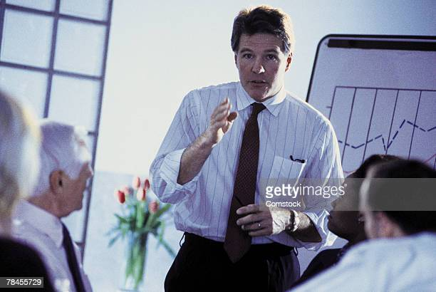 Man giving presentation at business meeting