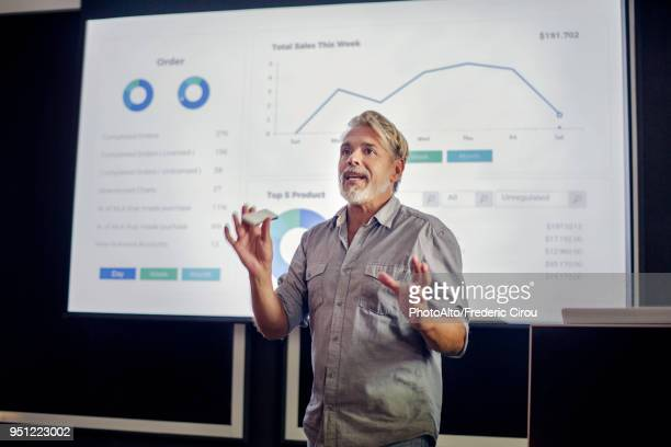man giving presentation - presentation stock pictures, royalty-free photos & images