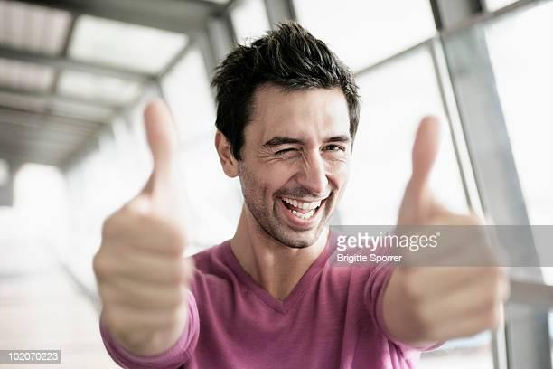 man giving two thumbs up - mid adult men imagens e fotografias de stock