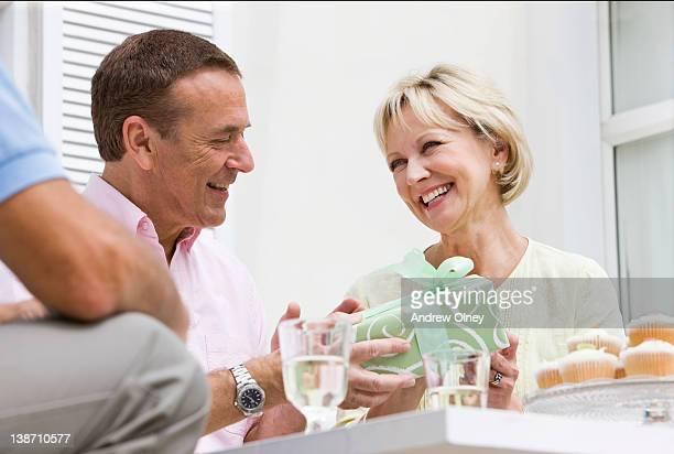 Man giving wife birthday gift