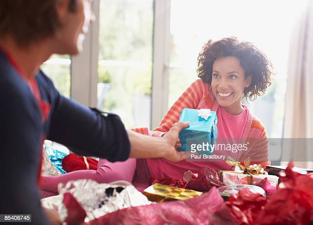 man giving wife christmas gift - giving stock photos and pictures