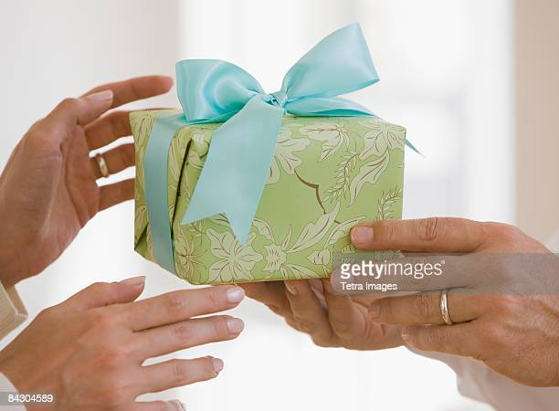 Man giving wife gift