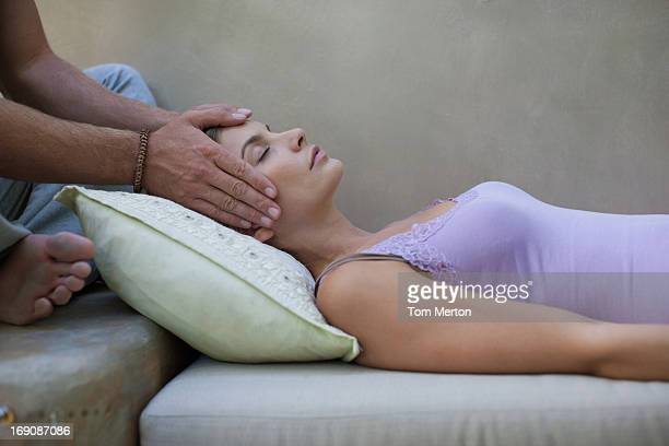 man giving woman head massage - husband massage wife stock photos and pictures