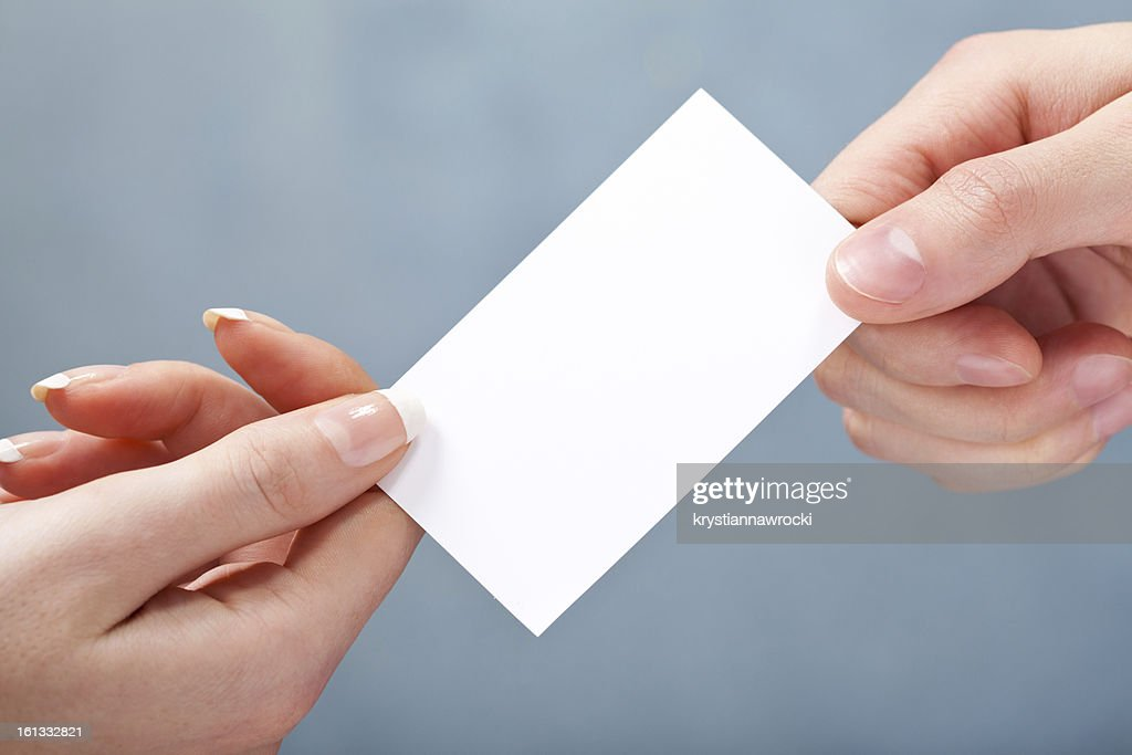 Man giving women blank business card on gray background stock photo man giving women blank business card on gray background stock photo reheart Gallery