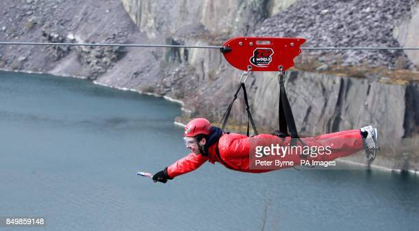 A man goes down the zip wire at Zip World in Penrhyn Quarry Bethesda Bangor North Wales