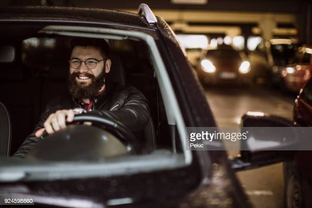 man goes out of the parking lot - car park stock pictures, royalty-free photos & images