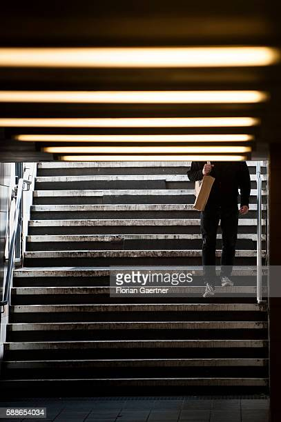Man goes the stairs down to a subway station on August 11, 2016 in Berlin, Germany.