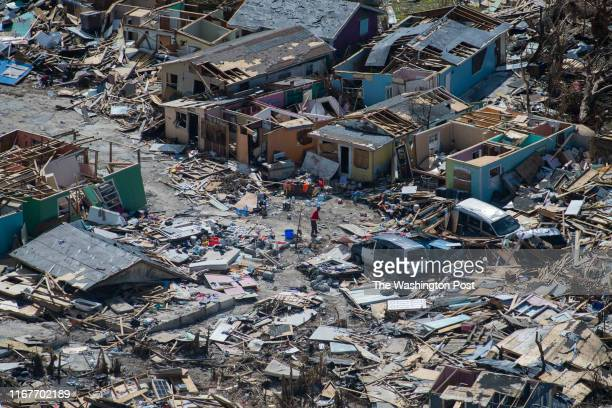 Man goes through damage and debris is seen in the Mudd and the Peas neighborhoods of Marsh Harbour, Bahamas after Hurricane Dorian on September 9,...