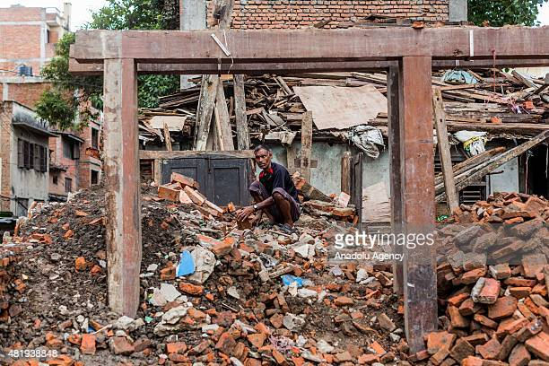 Man goes through debris of a destroyed building in Kathmandu on July 25, 2015. Today marks the 3 month anniversary of the Nepal earthquakes which at...