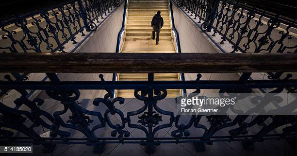 A man goes upstairs to the train station Treptower Park on March 07 2016 in Berlin Germany