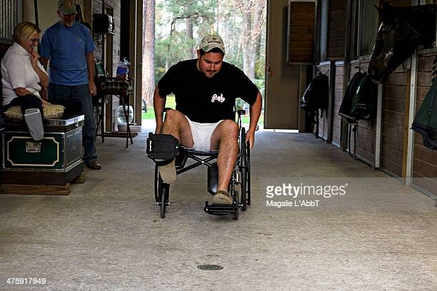 CONTENT] Man going forwards in a wheelchair while others watch on The wheelchair obstacle course was built using canned vegetables and each vegetable...