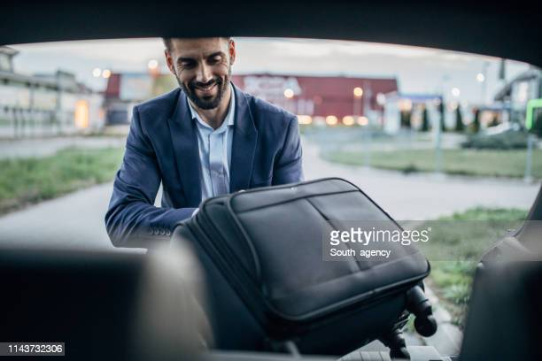 man going on travel - car trunk stock pictures, royalty-free photos & images