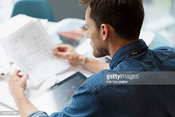 Man going over invoices in office