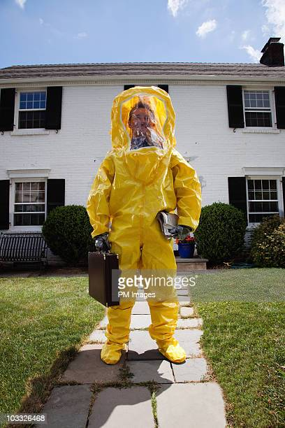 man going to work in haz mat suit - hazmat stock pictures, royalty-free photos & images