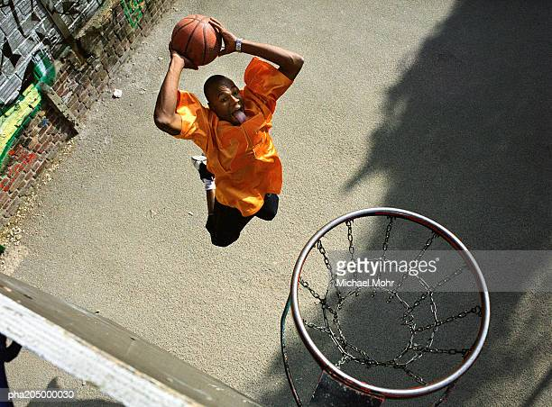 Man going up for a basketball dunk, shot from above