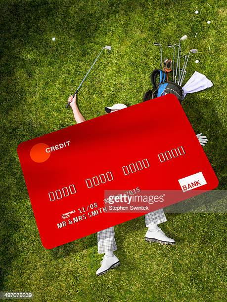 Man golfing crushed under oversized credit card
