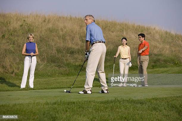 man golfing with friends - 50 59 years stock pictures, royalty-free photos & images