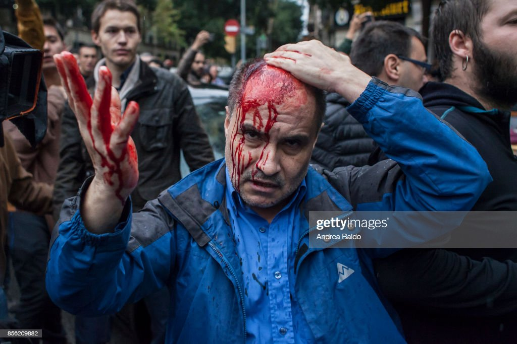 A man got hurt after being hit by a plastic bullet. People clash with the Spanish police 'Policia Nacional' after they closed down a polling station. Today the referendum was held to vote for the independence of Catalunya region.