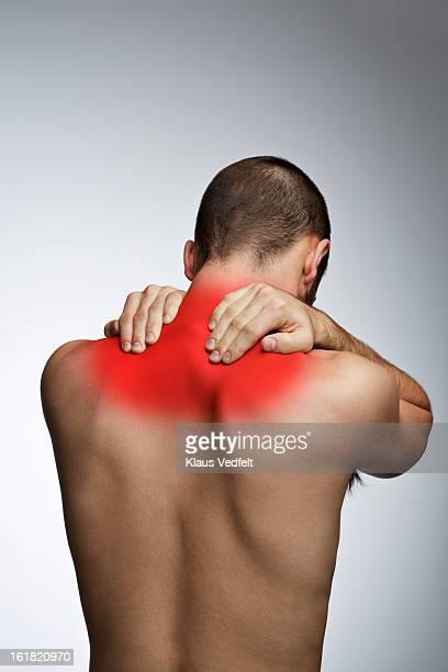 Man grabbing shoulders because of pain