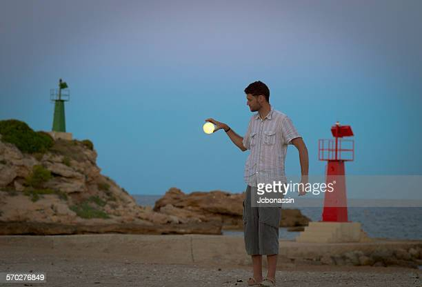 man grabbing the moon - jcbonassin stock pictures, royalty-free photos & images