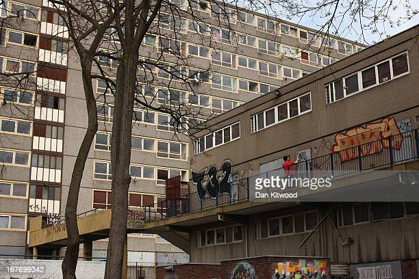 A man graffiti's a wall in the Heygate Estate in the Walworth area on April 24 2013 in London England The Heygate estate in central London was built...